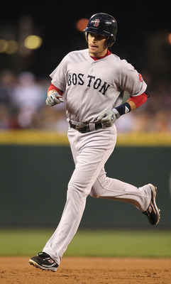SEATTLE - SEPTEMBER 14:  Jed Lowrie #12 of the Boston Red Sox rounds the bases after hitting a two-run home run against the Seattle Mariners at Safeco Field on September 14, 2010 in Seattle, Washington. (Photo by Otto Greule Jr/Getty Images)