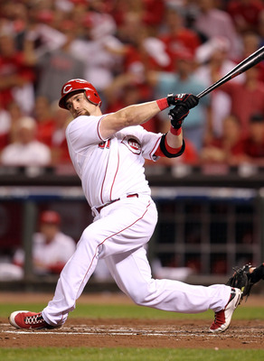 CINCINNATI - OCTOBER 10:  Jonny Gomes #31 of the Cincinnati Reds strikes out against the Philadelphia Phillies  during Game 3 of the NLDS at Great American Ball Park on October 10, 2010 in Cincinnati, Ohio.  (Photo by Andy Lyons/Getty Images)