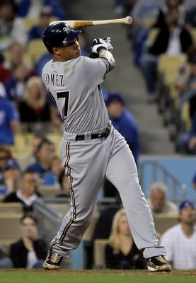 LOS ANGELES, CA - MAY 04:  Carlos Gomez #27 of the Milwaukee Brewers loses his bat in the second inning against the Los Angeles Dodgers at Dodger Stadium on May 4, 2010 in Los Angeles, California.  (Photo by Jeff Gross/Getty Images)