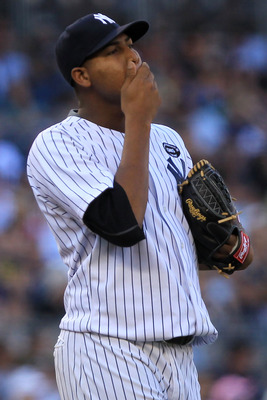 NEW YORK - SEPTEMBER 25:  Ivan Nova #47 of the New York Yankees reacts on the mound in the third inning against the Boston Red Sox during their game on September 25, 2010 at Yankee Stadium in the Bronx borough of New York City.  (Photo by Chris McGrath/Ge