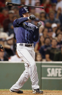 BOSTON - SEPTEMBER 08:  Brad Hawpe #11 of the Tampa Bay Rays loses control of his bat in the second inning against the Boston Red Sox on September 8, 2010 at Fenway Park in Boston, Massachusetts.  (Photo by Elsa/Getty Images)