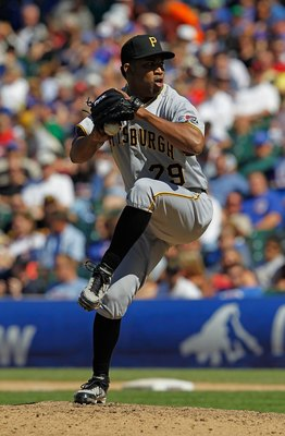 CHICAGO - JUNE 30: Octavio Dotel #29 of the Pittsburgh Pirates pitches in the 9th inning on his way to a save against the Chicago Cubs at Wrigley Field on June 30, 2010 in Chicago, Illinois. The Pirates defeated the Cubs 2-0. (Photo by Jonathan Daniel/Get