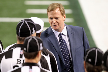 ARLINGTON, TX - FEBRUARY 06: NFL Commissioner Roger Goodell (R) speaks with Head Referee Walk Anderson during Super Bowl XLV at Cowboys Stadium on February 6, 2011 in Arlington, Texas.  (Photo by Mike Ehrmann/Getty Images)