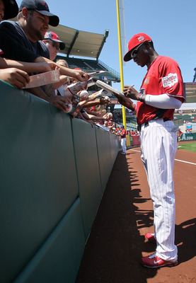 ANAHEIM, CA - JULY 11:  U.S. Futures All-Star Domonic Brown #3 of the Philadelphia Phillies signs autographs before the 2010 XM All-Star Futures Game at Angel Stadium of Anaheim on July 11, 2010 in Anaheim, California.  (Photo by Stephen Dunn/Getty Images