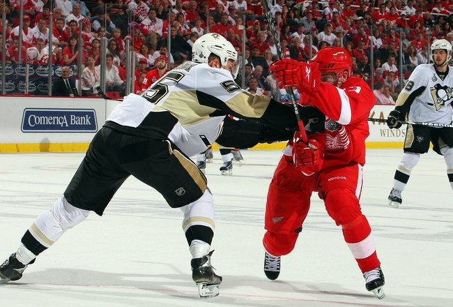 DETROIT - JUNE 12:  Sergei Gonchar #55 of the Pittsburgh Penguins defends against Pavel Datsyuk #13 of the Detroit Red Wings during Game Seven of the 2009 NHL Stanley Cup Finals at Joe Louis Arena on June 12, 2009 in Detroit, Michigan.  (Photo by Jim McIs