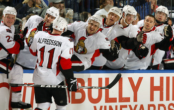 BUFFALO, NY - OCTOBER 22:  Daniel Alfredsson #11 of the Ottawa Senators celebrates his 1000th NHL point on a an empty net goal against the Buffalo Sabres  during their NHL game at HSBC Arena October 22, 2010 in Buffalo, New York.  (Photo By Dave Sandford/