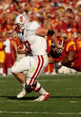 LOS ANGELES, CA - NOVEMBER 14:  Running back Toby Gerharrt #7 of the Stanford Cardinal carries the ball against linebacker Malcolm Smith #6 of the USC Trojans on November 14, 2009 at the Los Angeles Coliseum in Los Angeles, California.  Stanford won 55-21
