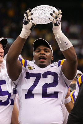 NEW ORLEANS - JANUARY 07: Glenn Dorsey #72 of the Louisiana State University Tigers raises the trophy after defeating the Ohio State Buckeyes 38-24 in the AllState BCS National Championship on January 7, 2008 at the Louisiana Superdome in New Orleans, Lou