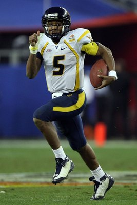 GLENDALE, AZ - JANUARY 02:  Quarterback Patrick White #5 of the West Virginia Mountaineers runs the ball against the Oklahoma Sooners at the Tostito's Fiesta Bowl at University of Phoenix Stadium January 2, 2008 in Glendale, Arizona.  (Photo by Jed Jacobs