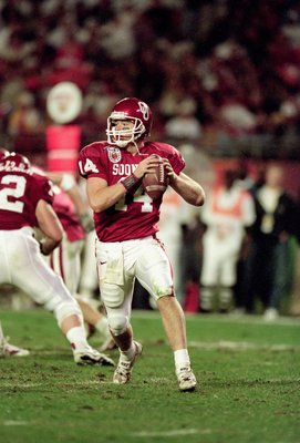 3 Jan 2001: Quarterback Josh Heupel #14 of the Oklahoma Sooners scrambles to pass the ball during the Orange Bowl Game against the Florida State Seminoles at the Pro Players Stadium in Miami, Florida.  The Sooners defeated the Seminoles 13-2.Mandatory Cre