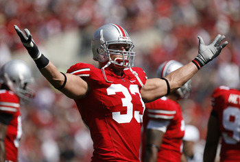 COLUMBUS, OH - SEPTEMBER 20: James Laurinaitis #33 of the Ohio State Buckeyes tries to get the fans loud in the second quarter while playing the Troy Trojans on September 20, 2008 at Ohio Stadium in Columbus, Ohio. Ohio State won the game 28-10.  (Photo b