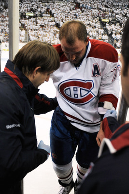 PITTSBURGH - APRIL 30:  Andrei Markov #79 of the Montreal Canadiens is assisted off the ice to the dressing room after being injured in the first period against the Pittsburgh Penguins in Game One of the Eastern Conference Semifinals during the 2010 NHL S