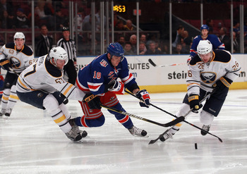 NEW YORK - NOVEMBER 11:  Tyler Myers #57 and Thomas Vanek #26 of the Buffalo Sabres trip up Marian Gaborik #10 of the New York Rangers at Madison Square Garden on November 11, 2010 in New York City.  (Photo by Bruce Bennett/Getty Images)