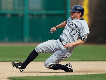CHICAGO - APRIL 15: Joe Inglett of the Milwaukee Brewers, wearing a number 42 jersey in honor of Jackie Robinson, slides into second base against the Chicago Cubs at Wrigley Field on April 15, 2010 in Chicago, Illinois. The Brewers defeated the Cubs 8-6.