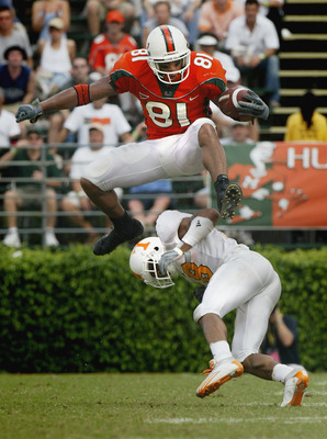 MIAMI - NOVEMBER 8:  Tight end Kellen Winslow #81 of the University of Miami Hurricanes jumps over defensive back Jason Allen #18 of the University of Tennessee Volunteers during the game at the Orange Bowl on November 8, 2003 in Miami, Florida. Tennessee