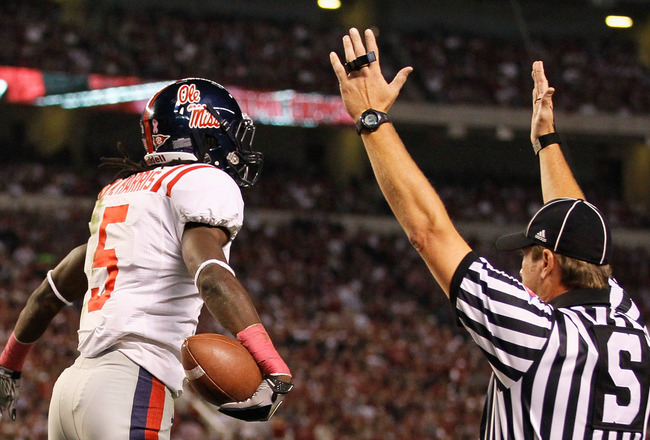 TUSCALOOSA, AL - OCTOBER 16:  Side judge Chris Jamison (R) signals a touchdown as Melvin Harris #5 of the Ole Miss Rebels reacts after scoring against the Alabama Crimson Tide at Bryant-Denny Stadium on October 16, 2010 in Tuscaloosa, Alabama.  (Photo by