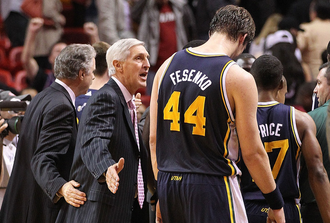 MIAMI - NOVEMBER 09: Utah Jazz head coach Jerry Sloan congratulates Kyrylo Fesenko after winning a game against the Miami Heat at American Airlines Arena on November 9, 2010 in Miami, Florida. NOTE TO USER: User expressly acknowledges and agrees that, by