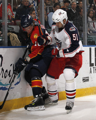 SUNRISE, FL - JANUARY 19: David Booth #10 of the Florida Panthers is checked by Fedor Tyutin #51 of the Columbus Blue Jackets on January 19, 2011 at the BankAtlantic Center in Sunrise, Florida. (Photo by Joel Auerbach/Getty Images)