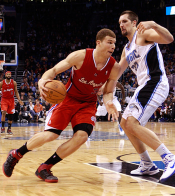 ORLANDO, FL - FEBRUARY 08:  Blake Griffin #32 of the Los Angeles Clippers attempts to drive past Ryan Anderson #33 of the Orlando Magic during the game at Amway Arena on February 8, 2011 in Orlando, Florida.  NOTE TO USER: User expressly acknowledges and