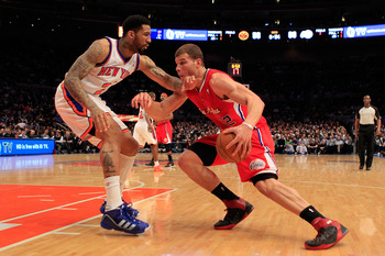 NEW YORK, NY - FEBRUARY 09:  Blake Griffin #32 of the Los Angeles Clippers drives against Wilson Chandler #21 of the New York Knicks at Madison Square Garden on February 9, 2011 in New York City. NOTE TO USER: User expressly acknowledges and agrees that,