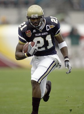 JACKSONVILLE, FL - DECEMBER 02: Calvin Johnson #21 of the Georgia Tech Yellow Jackets carries the ball against the Wake Forest Demon Deacons during the Atlantic Coast Conference Championship on December 2, 2006 at Alltel Stadium in Jacksonville, Florida.