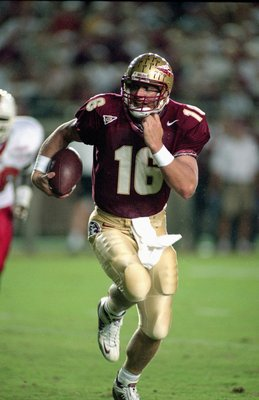 23 Sep 2000:  Quarterback Chris Weinke #16 of the Florida State Seminoles scrambles with the ball during the game against the Louisville Cardinals at the Doke Campbell Stadium in Talahassee, Florida. The Seminoles defeated the Cardinals 31-0.Mandatory Cre