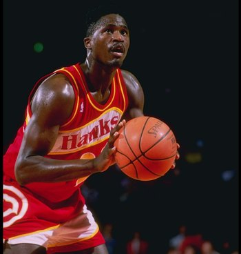 1990:  Forward Dominique Wilkins of the Atlanta Hawks stands at the foul line during a game.