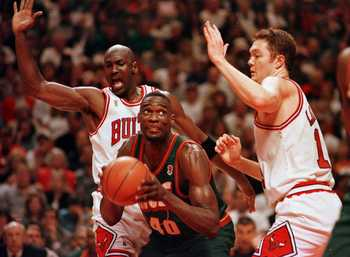 16 Jun 1996: Seattle Supersonic Shawn Kemp works to the basket between Chicago Bulls Michael Jordan and Luc Longley during fourth quarter action of game six of the NBA Finals at the United Center in Chicago, Illinois. The Bulls went on to defeat the Seatt