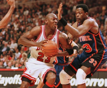 7 May 1996:   Michael Jordan of the Chicago Bulls drives around Patrick Ewing of the New York Knicks during second half action of their Eastern Conference NBA play-off semifinals at the United Center in Chicago, Illinois. The Bulls went on to beat the Kni