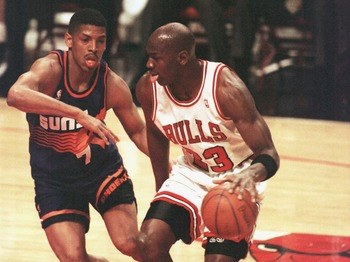 28 Jan 1996:  Forward Michael Jordan of the Chicago Bulls drives the lane past guard Kevin Johnson of the Phoenix Suns during first half action of the game at the United Center in Chicago, Illinois. The Bulls went on to beat the Suns 93-82, extending thei