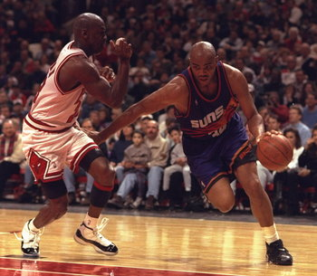28 Jan 1996:  Forward Charles Barkley #34 of the Phoenix Suns drives hard around Chicago Bull defender guard Michael Jordan #23 at the United Center in Chicago, Illinois. The Bulls defeated the Suns 93-82.  Mandatory Credit:  Jonathan Daniel/Allsport