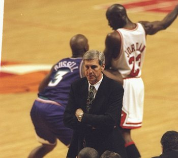 7 Jun 1998:  Head Coach Jerry Sloan of the Utah Jazz looks at his team as Michael Jordan #23 of the Chicago Bulls keeps the ball away from Bryon Russell #3 of the Jazz during the NBA Finals game 3 at the United Center in Chicago, Illinois.  The Bulls defe