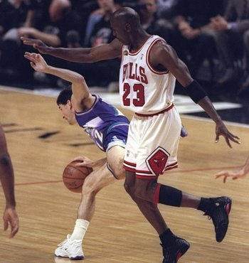 10 Jun 1998:  Michael Jordan #23 the Chicago Bulls in action against John Stockton of the Utah Jazz during the NBA Finals Game 4 at the United Center in Chicago, Illinois.  The Bulls defeated the Jazz 86-82. Mandatory Credit: Jonathan Daniel  /Allsport