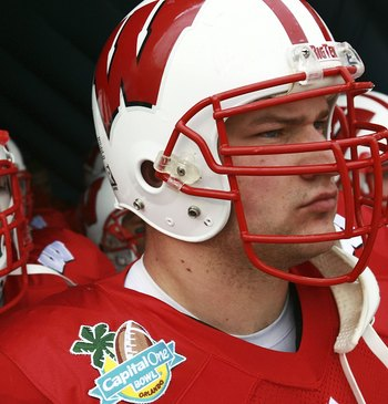 ORLANDO, FL - JANUARY 1:  Joe Thomas #72 and Kraig Urbik #63 of the Wisconsin Badgers prepare to lead their team onto the field to take on the Arkansas Razorbacks in the Capitol One Bowl at Florida Citrus Bowl January 1, 2007 in Orlando, Florida. Wisconsi