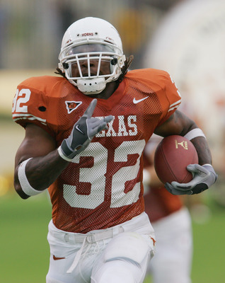 AUSTIN, TX - SEPTEMBER 25:  Running back Cedric Benson #32 of the University of Texas at Austin Longhorns carries the ball against the Rice University Owls during the game on September 25, 2004 at Royal-Memorial Stadium in Austin, Texas.  Texas won 35-13.