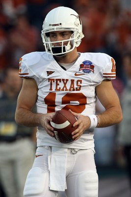 PASADENA, CA - JANUARY 07:  Quarterback Colt McCoy #12 of the Texas Longhorns looks on before taking on the Alabama Crimson Tide in the Citi BCS National Championship game at the Rose Bowl on January 7, 2010 in Pasadena, California.  (Photo by Stephen Dun