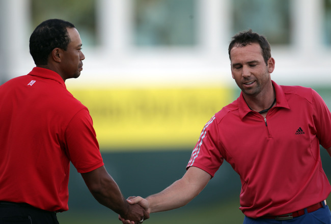 DUBAI, UNITED ARAB EMIRATES - FEBRUARY 13:  Tiger Woods of the USA and Sergio Garcia of Spain after the final round of the Omega Dubai Desert Classic on the Majlis course at the Emirates Golf Club on February 13, 2011 in Dubai, United Arab Emirates.  (Pho
