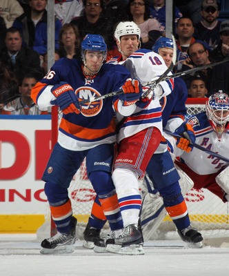 UNIONDALE, NY - DECEMBER 02: Matt Moulson #26 of the New York Islanders skates against Marc Staal #18 of the New York Rangers at the Nassau Coliseum on December 2, 2010 in Uniondale, New York.  (Photo by Bruce Bennett/Getty Images)