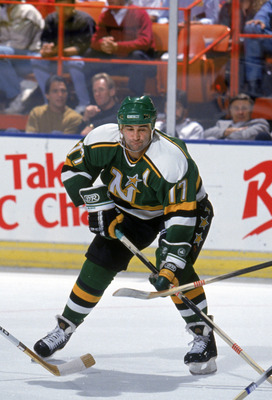 INGLEWOOD, CA - 1990:  Basil McRae #17 of the Minnesota North Stars battles for the puck during a game against the Los Angeles Kings in the 1990-1991 NHL season at the Great Western Forum in Inglewood, California.  (Photo by Rick Stewart/Getty Images)