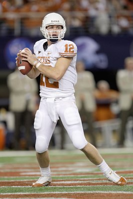 ARLINGTON, TX - DECEMBER 5: Colt McCoy #12 of the Texas Longhorns looks to pass the ball during the Big 12 Football Championship game against the Nebraska Cornhuskers at Cowboys Stadium on December 5, 2009 in Arlington, Texas. (Photo by Jamie Squire/Getty