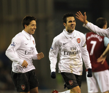 BURNLEY, ENGLAND - DECEMBER 16:  Cesc Fabregas of Arsenal celebrates with Samir Nasri and Mikael Silvestre after scoring the opening goal during the Barclays Premier League match between Burnley and Arsenal at Turf Moor on December 16, 2009 in Burnley, En
