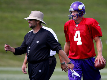 EDEN PRAIRIE, MN - AUGUST 18:  Minnesota Vikings Head Coach Brad Childress (L) walks with Brett Favre #4 after finishing  a passing drill during a Minnesota Vikings practice session on August 18, 2009 at Winter Park in Eden Prairie, Minnesota. Favre has r