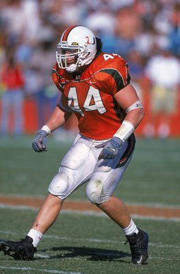 4 Nov 2000: Dan Morgan #44 of the Miami Hurricanes moves in to position during the game against the Virginia Tech Hokies at the Orange Bowl in Miami, Florida. The Hurricanes defeated the Hokies 41-21.Mandatory Credit: Scott Halleran  /Allsport