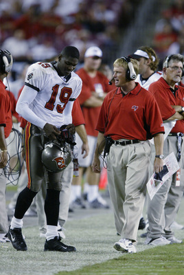 TAMPA, FL - SEPTEMBER 23:  Head coach Jon Gruden of the Tampa Bay Buccaneers talks to wide receiver Keyshawn Johnson #19 during the NFL game against the St. Louis Rams on September 23, 2002 at Raymond James Stadium in Tampa, Florida. The Buccaneers won 26