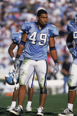 10 Nov 2001:  Defensive End Julius Peppers #49 of the North Carolina (UNC) Tar Heels holding hishelmet while standing on the field during the game against the Wake Forest Demon Deacons at the Kenan Stadium in Chapel Hill, North Carolina. The Demon Deacons