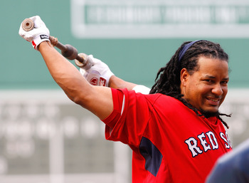 BOSTON - JULY 30: Manny Ramirez #24 of the the Boston Red Sox stretches before taking batting practice prior to a game against the Los Angeles Angels of Anaheim throws against the Boston Red Sox at Fenway Park on July 30, 2008 in Boston, Massachusetts.  (