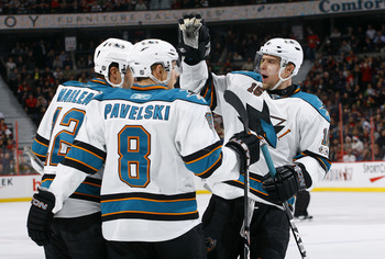 OTTAWA, ON - DECEMBER 02:  Patrick Marleau #12 of the San Jose Sharks celebrates his goal against the Ottawa Senators with teammates Joe Pavelski #8 and Dany Heatley #15 in a game at Scotiabank Place on December 2, 2010 in Ottawa, Ontario, Canada.  (Photo