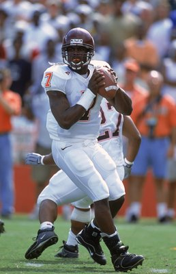 4 Nov 2000: Michael Vick #7 of the Virginia Tech Hokies drops back to pass the ball during the game against the Miami Hurricanes at the Orange Bowl in Miami, Florida. The Hurricanes defeated the Hokies 41-21.Mandatory Credit: Scott Halleran  /Allsport