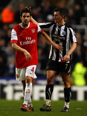 NEWCASTLE UPON TYNE, ENGLAND - FEBRUARY 05:  Cesc Fabregas of Arsenal and Joey Barton of Newcastle at the final whistle during the Barclays Premier League match between Newcastle United and Arsenal at St James' Park on February 5, 2011 in Newcastle upon T