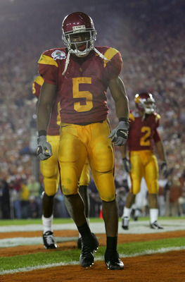 PASADENA, CA - JANUARY 04:  Reggie Bush #5 of the USC Trojans stands in the end zone after scoring a 26 yard touchdown in the fourth quarter of the BCS National Championship Rose Bowl Game against the Texas Longhorns at the Rose Bowl on January 4, 2006 in